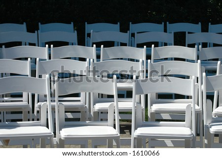Rows of white chairs - stock photo