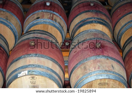 rows of wine barrels - stock photo