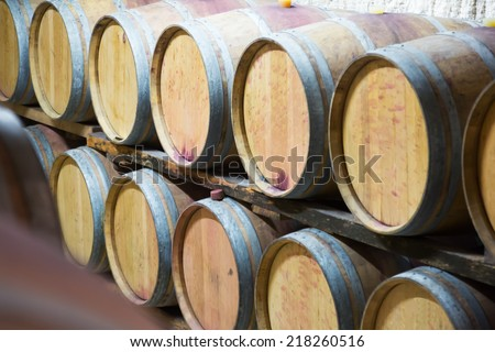 Rows of   wooden barrels in french winemaker   - stock photo