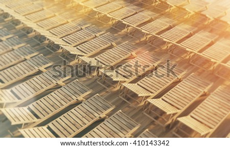 Rows of wooden chaise longues. Filtered. Topview, 3D Rendering - stock photo