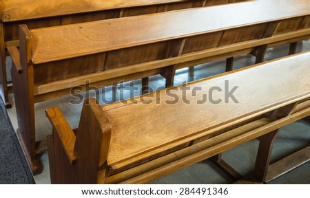 Rows of wooden church benches without anybody from close. - stock photo