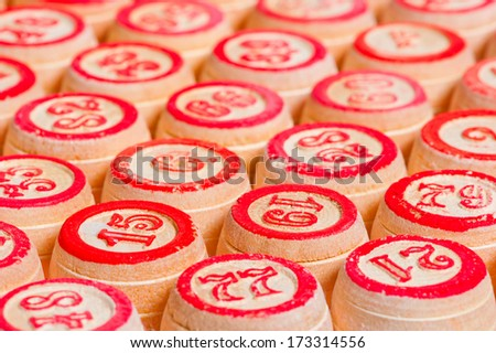 rows of wooden kegs for bingo - stock photo