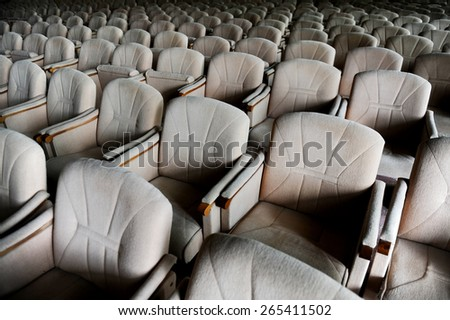 Rows with lots of empty beige velvet armchairs in a big conference room - stock photo