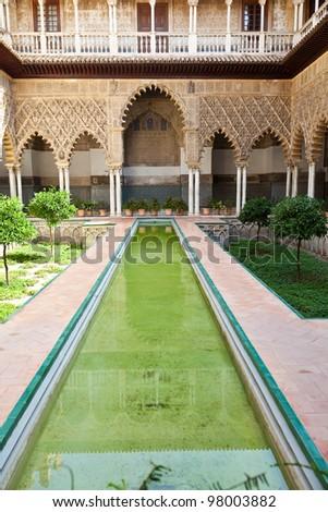 Royal Alcazar of Sevilla. Pond in the Wrists court of mudejar palace - stock photo