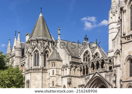 Royal Courts of Justice in the Victorian Gothic style (Law Courts, designed by George Edmund Street, 1882) in London, UK. - stock photo
