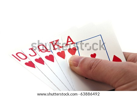 Royal Flush A hand holding a heart suited royal flush. Horizontal. - stock photo