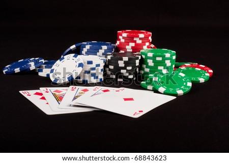 Royal Flush and Poker Chips - stock photo