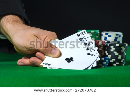 Royal Flush in poker and betting chips - stock photo