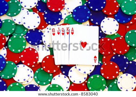 Royal Flush on a pile of poker chips - stock photo