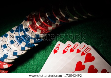royal flush on poker table - stock photo