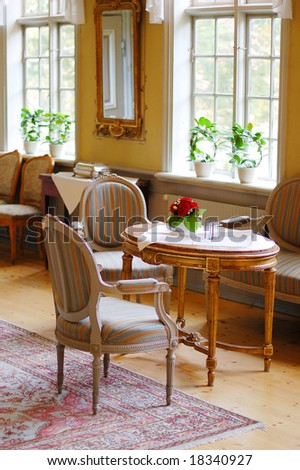 Royal furniture in old Manor - stock photo