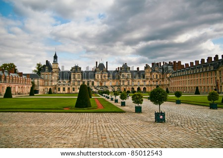 Royal hunting castle Fontainbleau near Paris in France and park. - stock photo