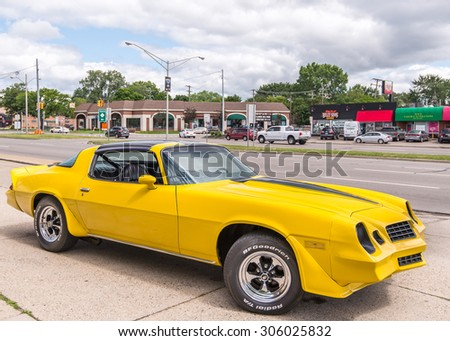 ROYAL OAK, MI/USA - AUGUST 12, 2015: A 1979 Chevrolet Camaro and M-1 (Woodward) sign at the Woodward Dream Cruise, the world's largest one-day automotive event. - stock photo
