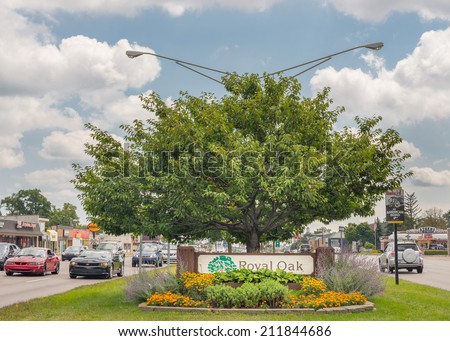 ROYAL OAK, MI/USA - AUGUST 17, 2014: The annual Woodward Dream Cruise route runs through Royal Oak. The Dream Cruise is the world's largest one-day automotive event. National Scenic Byway - stock photo