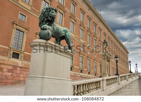 "Royal Palace (""Kungliga Slottet"") and statue of a lion guard in Stockholm, Sweden."