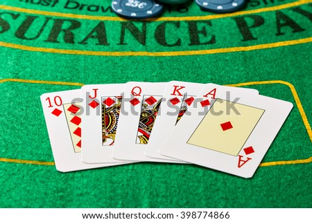 Royal Straight Flush with poker chips. Horizontal image.
