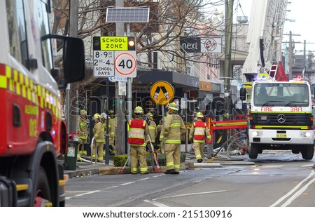 ROZELLE, AUSTRALIA - SEPTEMBER 4, 2014; A team of firemen and engineers at work after a shop explosion in Rozelle.