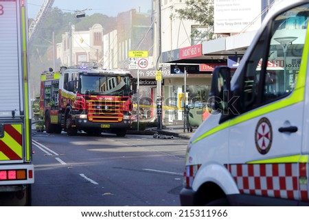 ROZELLE, AUSTRALIA - SEPTEMBER 4, 2014;   Fire search and rescue teams and ambulance crew attend the shop blast tragedy in Darling Street, Rozelle. - stock photo