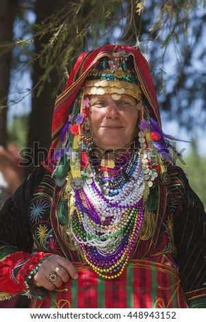 ROZHEN, BULGARIA, JULY 18, 2015: Woman in traditional folk costume of famous rozhen folklore festival in bulgaria