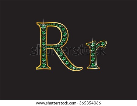 Rr in stunning emerald precious round jewels set into a 2-level gold gradient channel setting, isolated on black. High-resolution raster JPEG version.  - stock photo