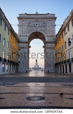 Rua Augusta Arch at dawn in Lisbon, Portugal. Statue of King Jose I on Commerce Square at the far end.