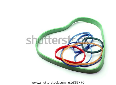 Rubber bands in a heart shape on a white background with space. - stock photo