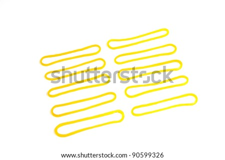 rubber bands on a white background, closeup of pictures - stock photo