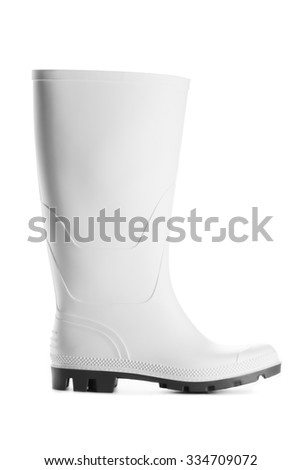 Rubber boot isolated on white background - stock photo