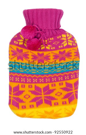 rubber hot water bottle in a knitted cover color on a white background - stock photo