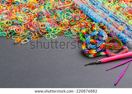 Rubber loom bands used to produce colourful wrist bands - stock photo