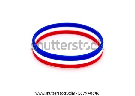 rubber plastic stretch thai flag bracelet isolated on white background. - stock photo