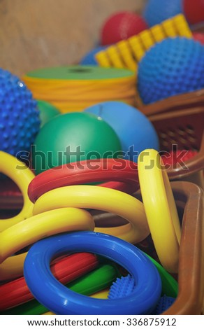 Rubber rings and balls at playground. Close-up photo - stock photo