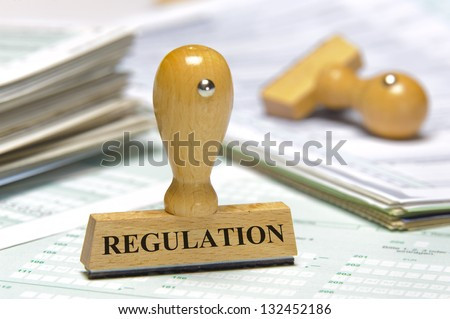 rubber stamp marked with regulation - stock photo