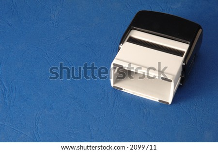 Rubber stamp on a blue background - stock photo