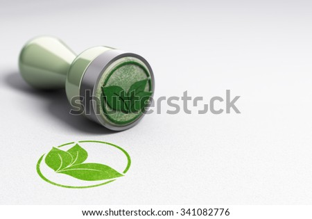 Rubber stamp over paper background with leaves symbol printed on it. Concept image for eco friendly communication.
