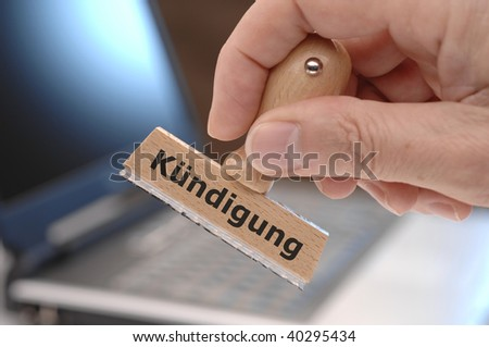"rubber stamp with inscription ""Kuendigung"" - in english dismissal"
