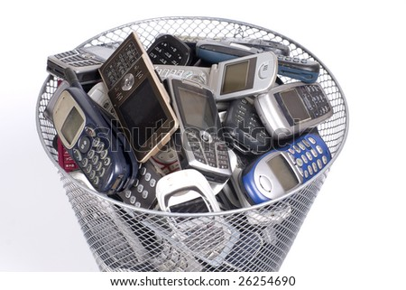rubbish bin full of old cellphones - stock photo