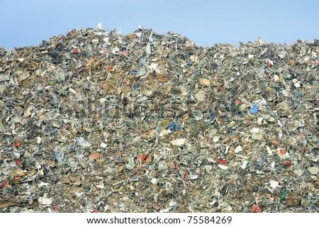 rubbish dump of landfill garbage - no visible trademarks - stock photo