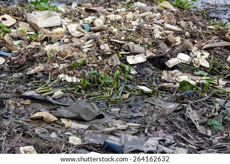 Rubbish pollution on the Saigon river bank in Vietnam - stock photo