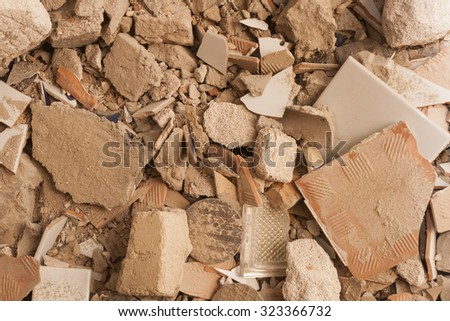 Rubble background. Pile of rubble composed of bricks and cinder block - stock photo