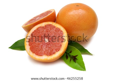Ruby Grapefruits with leaves isolated on white with clipping path
