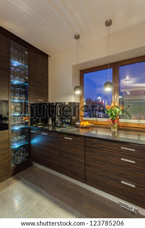 Ruby house - modern and new kitchen, highlight kitchen cabinet - stock photo
