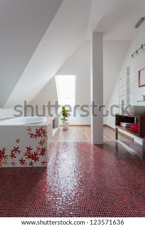 Ruby house - Original modern bathroom interior with red floor