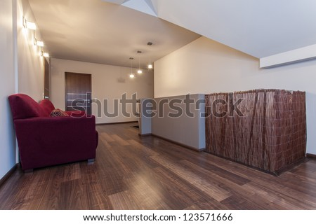 Ruby house - Stylish sofa on the attic in a hallway - stock photo