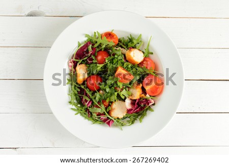 Rucola salad with tomato and fried chicken - stock photo