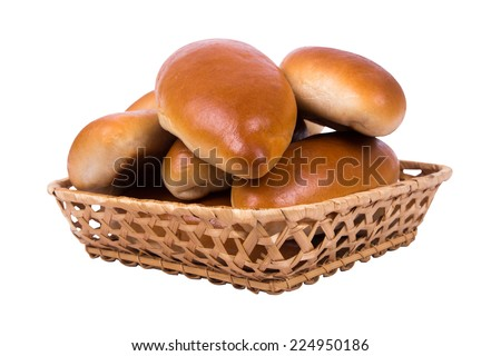 Ruddy small pies in wattled basket isolated on white background - stock photo