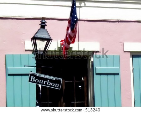 Rue Bourbon, the most famous street in New Orleans' French Quarter. - stock photo