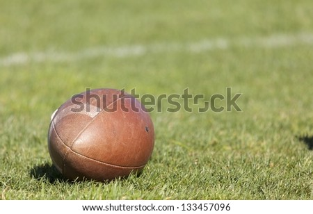 Rugby ball at green grass. Photo taken at rugby training - stock photo