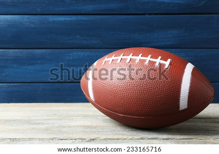 Rugby ball on wooden background - stock photo