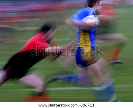 Rugby Match - winger races away - stock photo